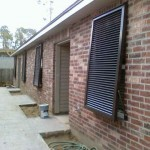 Aluminum Bahama Shutters installed on a Thibodaux apartment complex in 2009
