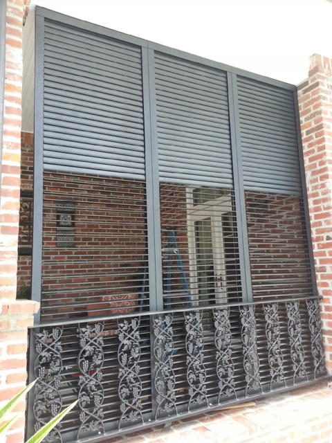Wall of shutters made of Operable Louver Shutters
